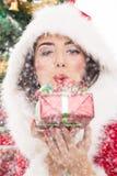 Santa girl blowing snow royalty free stock photography