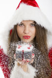 Santa girl blowing snow Stock Photo