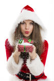 Santa girl blowing snow Royalty Free Stock Photo