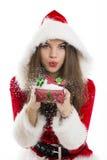 Santa girl blowing snow royalty free stock photo