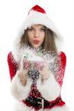 Santa girl blowing snow royalty free stock image