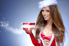 Santa girl on blue background Stock Images