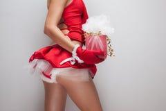 Santa girl body holding gift Royalty Free Stock Photography