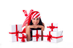 Santa girl is with a bunch of gifts. Holidays Christmas and New Stock Images