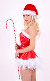 Santa girl with candy cane stick on white Stock Photo