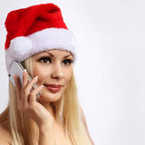 Santa Girl with Cell Phone. Blonde Happy Young Woman Stock Photo