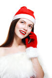Santa Girl with Cell Phone Royalty Free Stock Photo