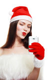 Santa Girl with Cell Phone Stock Images