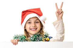 Santa girl child victory sign with billboard Royalty Free Stock Images