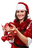 Santa girl with Christmas balls Royalty Free Stock Photography