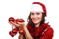 Santa girl with Christmas balls Stock Photo