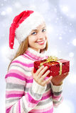 Santa girl with a Christmas box Stock Image