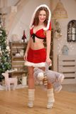 Santa girl in Christmas costume with cute teddy bear Stock Image