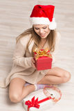 Santa girl with Christmas gift Royalty Free Stock Images