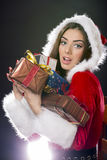 Santa girl with Christmas gifts. Royalty Free Stock Photography