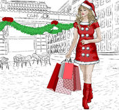 Santa girl with christmas gifts Royalty Free Stock Photography