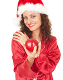 Santa girl in Christmas hat with red apple Royalty Free Stock Images