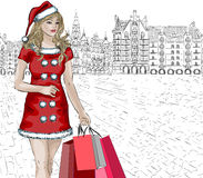 Santa girl with christmas purchases on city backgr Stock Photo