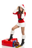 Santa girl with Christmas shopping bag Royalty Free Stock Image