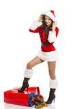 Santa girl with Christmas shopping bag Royalty Free Stock Image