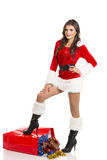 Santa girl with Christmas shopping bag Royalty Free Stock Photos