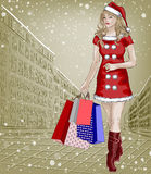 Santa girl with christmas shopping packages on cit Stock Photography