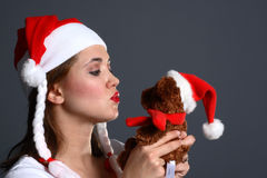 Santa girl with Christmas teddy Royalty Free Stock Photography