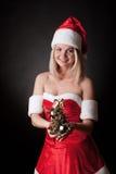 Santa girl with Christmas tree. royalty free stock photo