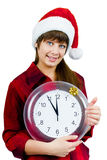 Santa girl with the clock Royalty Free Stock Photography