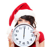 Santa girl with clock Royalty Free Stock Photography