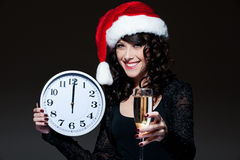 Santa girl with clock and glass Stock Image