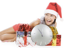 Santa girl with clock showing midnight Royalty Free Stock Photo