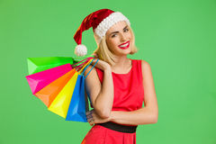 Santa girl with colorful shopping bags Stock Images