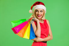 Santa girl with colorful shopping bags Royalty Free Stock Photo