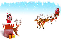 Santa girl coming from chimney with sleigh Stock Photography
