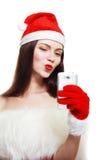 Santa Girl con el teléfono celular Imagenes de archivo