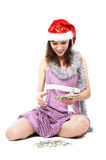Santa girl counts the money Stock Photography