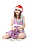 Santa girl counts the money Stock Photo