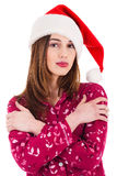 Santa girl covering herself with her hands Stock Photo