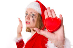 Santa girl cries humor heart Royalty Free Stock Image