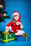 Santa girl with Cristmas gifts Royalty Free Stock Images
