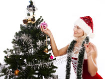 Santa girl decorating christmas tree Royalty Free Stock Photos
