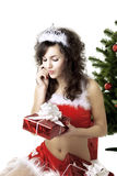 Santa girl deploying boxes with gifts Royalty Free Stock Images