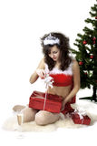 Santa girl deploying boxes with gifts. Images of the beautiful Santa girl which deploying boxes with gifts Stock Photos
