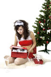 Santa girl deploying boxes with gifts. Images of the beautiful Santa girl which deploying boxes with gifts Royalty Free Stock Images