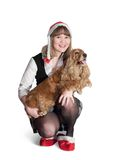 Santa girl and dog Royalty Free Stock Photos
