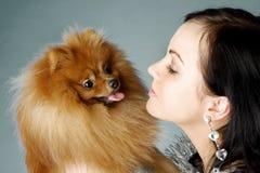Santa girl and dog Royalty Free Stock Image