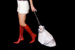 Santa-Girl dragging bag with gifts Stock Image