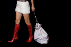 Santa-Girl dragging bag with gifts Royalty Free Stock Image