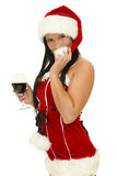 Santa girl drinking Stock Image